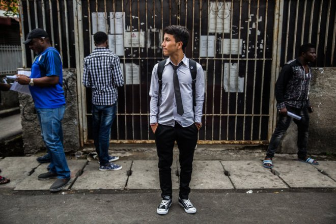 Sardar Hussain, 16, in front of the United Nations office for refugees in Jakarta, Indonesia. The Afghan boy, who was orphaned by a Taliban bomb, was days away from boarding a plane to the United States. Credit Kemal Jufri for The New York Times